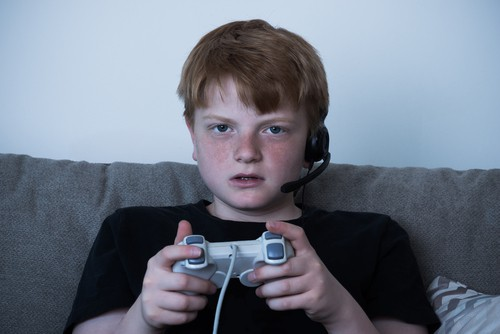 Boy With A Joystick Playing Videogames